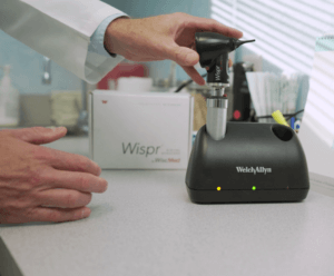 Physician placing Wispr in charging stand